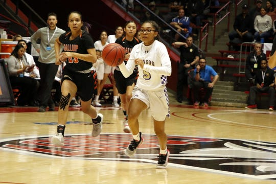 Kirtland Central's Aisha Ramone steals the ball and starts a fastbreak for a layup during the first half of their 4A quarterfinals game against Gallup on March 10, 2020 at The Pit in Albuquerque.