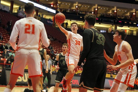 Artesia's Clay Houghtaling goes for a layup against Hope Christian on March 11, 2020 at The Pit in Albuquerque. Houghtaling finished with seven points. Hope Christian won, 61-26.