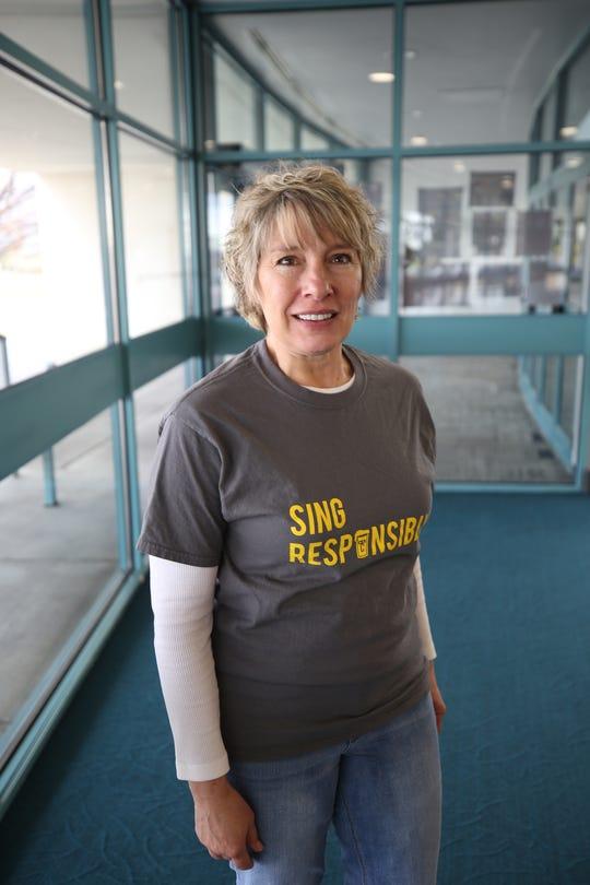 Choral director and San Juan College instructor Virginia Nickels-Hircock models a Beer Choir T-shirt.
