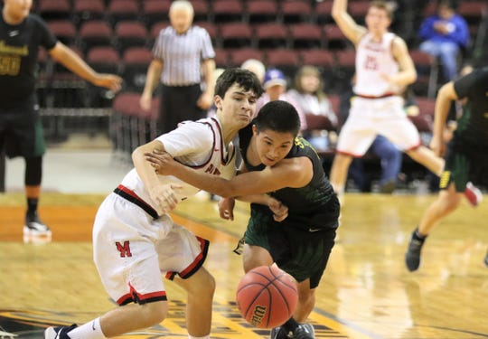 Newcomb's Deontay Begay comes up with a loose ball steal against Menaul's Alex Rael and scores a fast-break layup during Wednesday's NMAA boys basketball 2A state quarterfinals game at the Santa Ana Star Center in Rio Rancho.