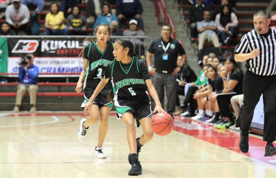 Farmington's Kapiolani Anitielu looks to pass the ball down the right side against Piedra Vista during Tuesday's NMAA 5A girls basketball state quarterfinals game at Dreamstyle Arena in Albuquerque.
