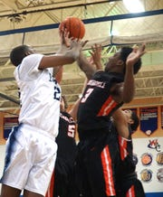 Three Churchill Chargers and a Thurston Eagle go up for a rebound.