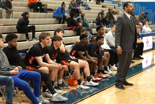 The Churchill Charger bench watches their teammates on the court near the end of the first half.