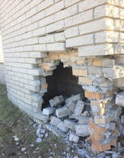 This 10-foot-high brick wall near the entrance to Canton's Holiday Park subdivision was damaged during a June 2019 car crash.