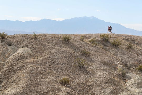 Hikers walk along the new Indio Hills Badlands hiking trail in north Indio, March 6, 2020.