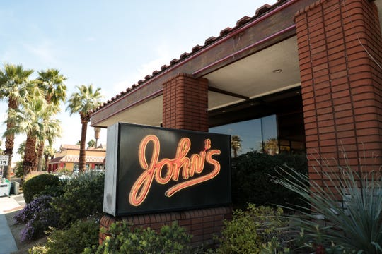 A sign for John's Restaurant in Palm Desert, Calif. sits outside of the building on Wednesday, March 11, 2020.