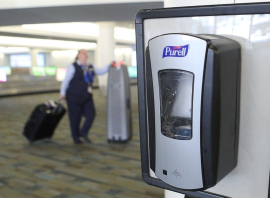 One of many had sanitization stations at Palm Springs International Airport, March 11, 2020.