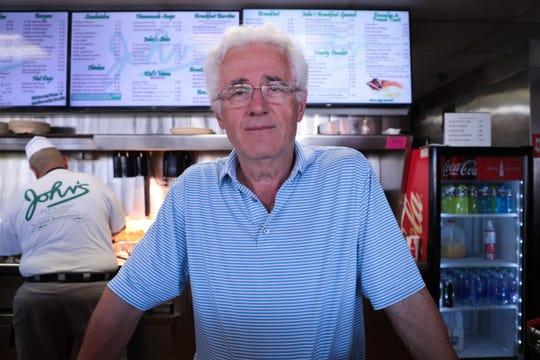John's Restaurant owner George Argyros poses for a photo inside his restaurant on Wednesday, March 11, 2020, in Palm Desert, Calif.