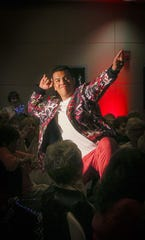Officer Mark Robles of the Indio Police Officers Association gets his groove on during the fashion portion of the event.