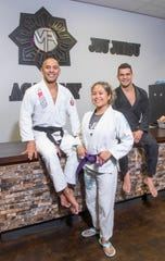 From left, Pace Gracie Jiu-Jitsu Academy owners Marcello Alcantar and Jasmin Alcantar and instructor Jackson Matos pose for a photo March 10.