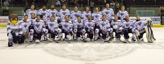 The Pensacola Ice Flyers pose in special Autism Awareness uniforms for a game last Saturday against Fayetteville. Over $25,000 was raised for the cause.