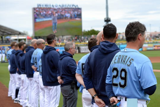 Seattle Mariners manager Scott Servais looks on during the national anthem prior to facing the Los Angeles Angels at Peoria Stadium. Could the Mariners stay in Arizona to open the regular season because of the coronavirus?