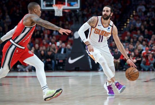 Mar 10, 2020; Portland, OR, USA; Phoenix Suns guard Ricky Rubio (11) handles the ball against Portland Trail Blazers guard Damian Lillard (0) during the first quarter at the Moda Center. Mandatory Credit: Craig Mitchelldyer-USA TODAY Sports