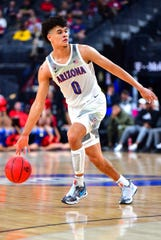 Mar 14, 2020; Las Vegas, Nevada, USA;  Arizona Wildcats guard Josh Green (0) dribbles during the first half against the Washington Huskies at T-Mobile Arena. Mandatory Credit: Stephen R. Sylvanie-USA TODAY Sports