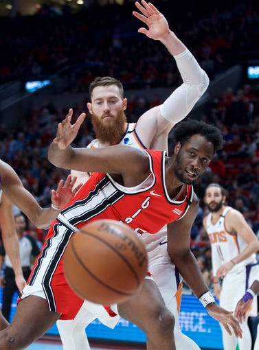 Mar 10, 2020; Portland, OR, USA; Portland Trail Blazers forward Caleb Swanigan (50) loses the ball against Phoenix Suns center Aron Baynes (behind) during the second quarter at the Moda Center. Mandatory Credit: Craig Mitchelldyer-USA TODAY Sports