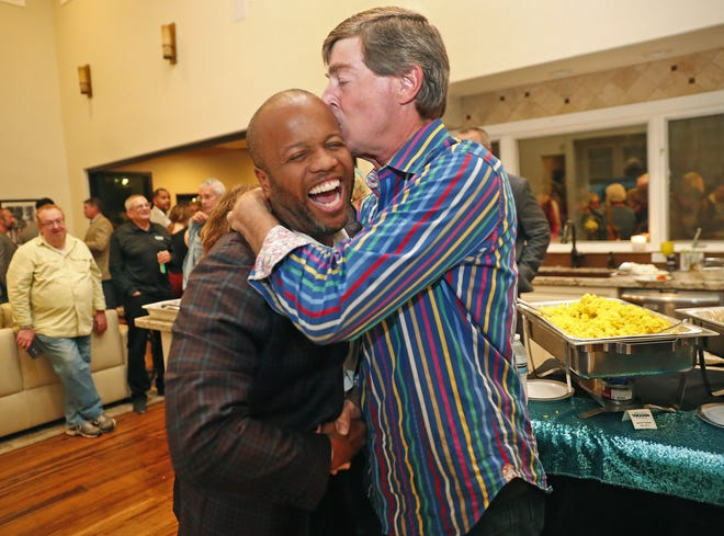 Corey Woods gets a kiss from former Tempe Mayor Hugh Hallman at an election night party on March 10, 2020. Woods unseated incumbent Mark Mitchell for the Tempe mayor's seat.