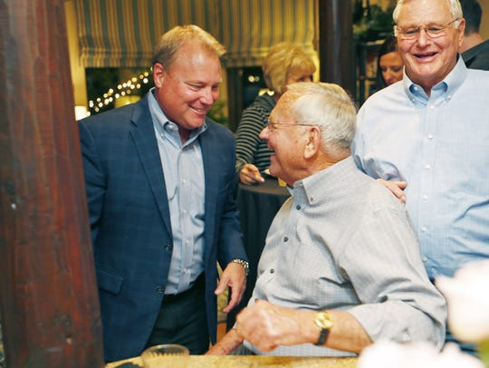 Tempe Mayor Mark Mitchell talks to his father, former Tempe mayor Harry Mitchell, at an election night party in Tempe on March 10, 2020.