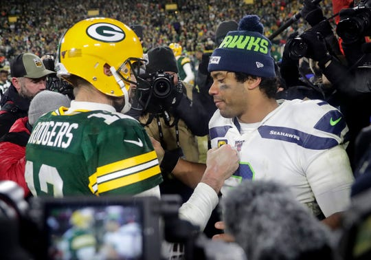 Green Bay Packers quarterback Aaron Rodgers (12) and Seattle Seahawks quarterback Russell Wilson (3) are two of the highest paid players in the NFL for the 2020 season.