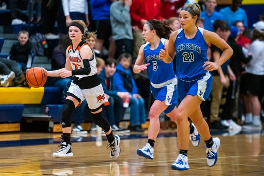 Lake Fenton's Morgan Furey (5) and Sydney Hammis (21) follow Marine City's Morgan McConnell as she dribbles the ball down the court during the MHSAA Division 2 regional semifinal Tuesday, March 10, 2020, at Goodrich High School.