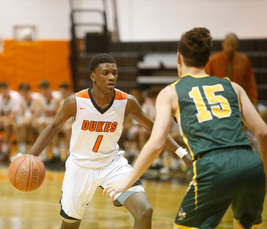 Marlboro's Korbyn Samules is covered by Hastings' Keith Capuano during the Class B Regional Boys Basketball Semifinal on March 11, 2020.