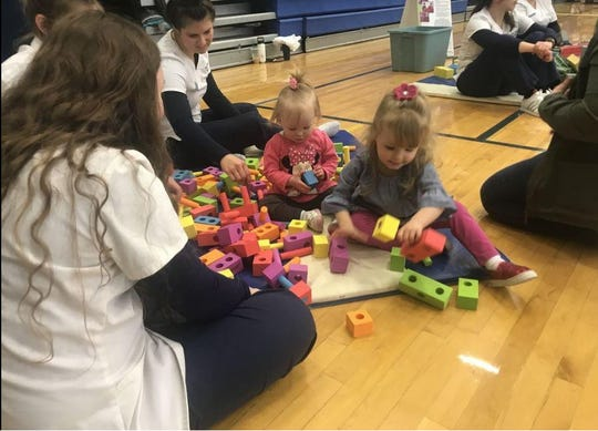 Parents, children and volunteers participate in a recent Block Fest hosted by Waynesboro Area School District.