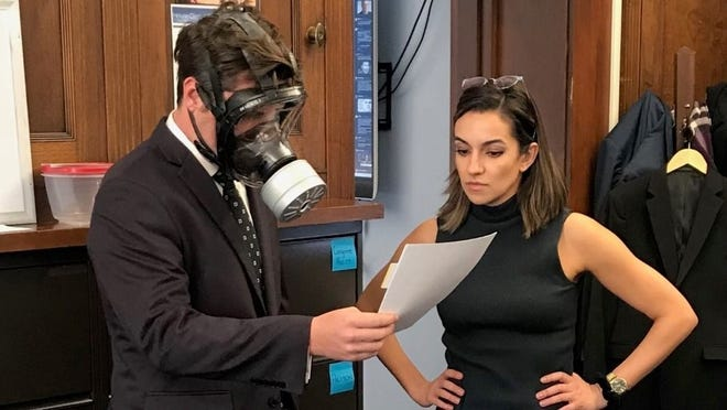 U.S. Rep. Matt Gaetz, R-Fla., wears a gas mask March 4, 2020 on the floor of Congress. Days later, he self-quarantined after being exposed to coronavirus.