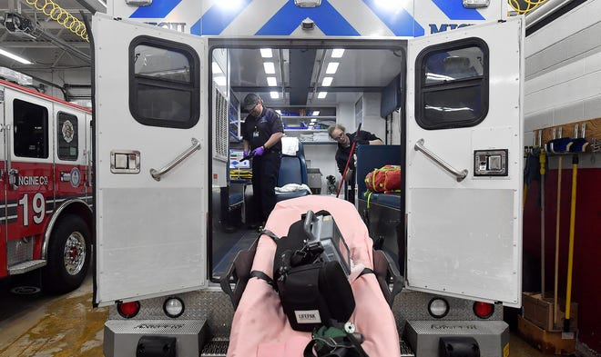 EMT Cory Boggs, left, and EMT Bethany Test perform routine, shift-change cleaning on the ambulances at at York Regional EMS ,Wednesday, March 11, 2020.John A. Pavoncello photo
