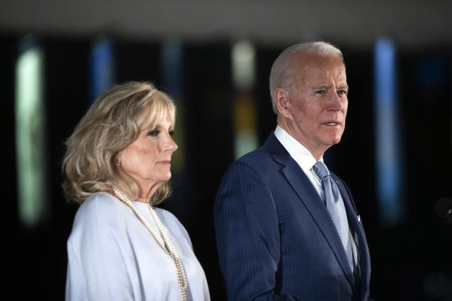 Democratic presidential candidate former Vice President Joe Biden, accompanied by his wife Jill, speaks to members of the press at the National Constitution Center in Philadelphia, Tuesday, March 10, 2020. (AP Photo/Matt Rourke)