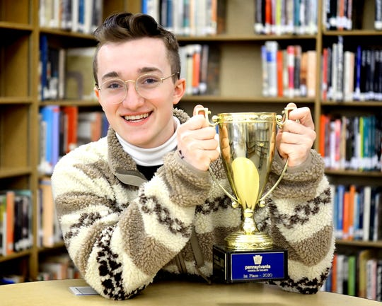 York Suburban junior Steven File, 16, holds a trophy in the school library, Wednesday, March 11, 2020, he received after becoming the Pennsylvania's state champion of thePoetry Out Loudcompetition earlier this month. He will represent the state at a national competition in Washington D.C. in April. Bill Kalina photo