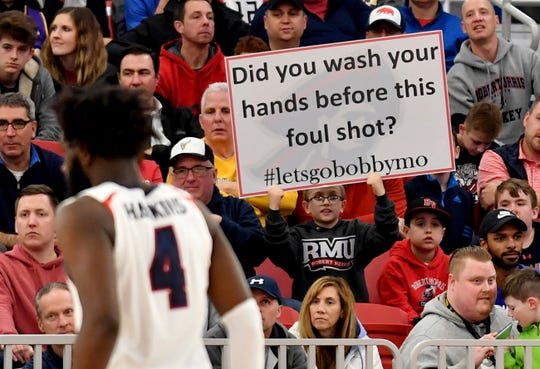 A Robert Morris fan holds up a sign during the team's NCAA college basketball game against St. Francis for the Northeast Conference men's tournament title Tuesday, March 10.