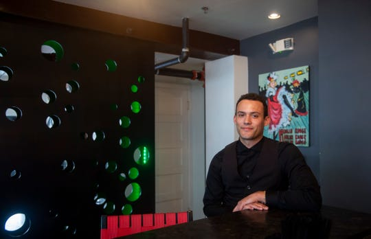 Jordan Preston, 27, a server at Handsome Cab in downtown York is one of several hospitality workers who do not have health insurance.