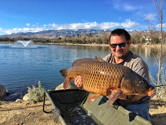 Brenden Burnham of Sparks with a state record carp he caught at Virginia Lake on Sunday, March  8.