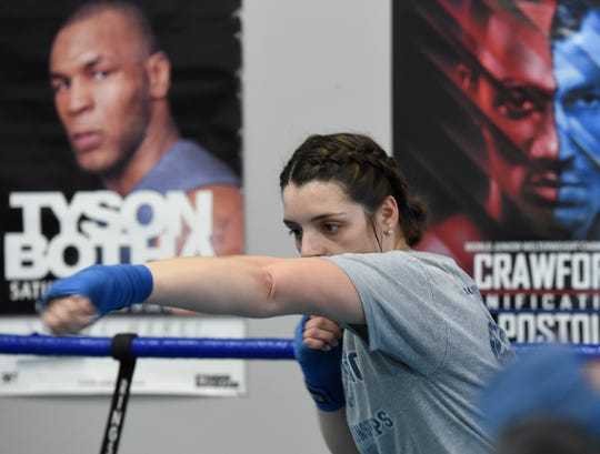 Nevada boxing club boxer McKain Murdock shadowboxes  at the club gym on Tuesday. She will be competing in the regionals this weekend.