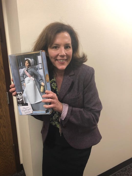 Karen Davis with a collectible Florence Nightingale doll.