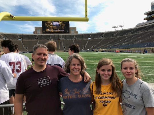 Justin DelVecchio and Brenda Wonder with daughter Emilia, in yellow,, during a college visit to Notre Dame. Emilia DelVecchio was accepted to the Top 15 school but will not attend.
