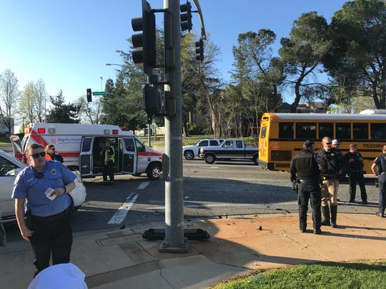 Redding police investigate a crash between a school bus and car on Wednesday morning, March 11, 2020 at Bechelli Lane and South Bonnyview Road.