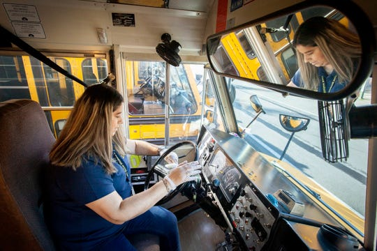 Salem-Keizer Public Schools bus driver Maria Bazuareyes goes over her bus with disinfecting wipes after her morning runs March 11, 2020. This effort is above and beyond the normal daily cleaning as the school district is taking extra precautions agains the coronavirus.
