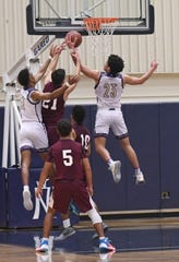 San Saba High School's Abel Martinez (23) and Sean O'Keefe, left, stop a La Pryor shot attempt during a regional quarterfinal game March 3, 2020. With the win, San Saba returned to the regional tournament for the first time since 1990.