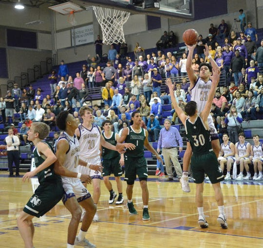 San Saba High School's Abel Martinez (23) shoots over a player from Normangee during the Region IV-2A championship game, Saturday, March 7, 2020, at the Snake Pit at San Marcos High School.