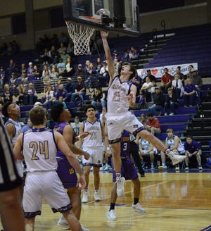 San Saba High School's Logan Glover (21) goes up for a shot during a Region IV-2A semifinal boys basketball game Friday, March 6, 202, at the Snake Pit at San Marcos High School.