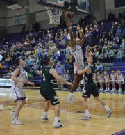 San Saba High School's Sean O'Keefe (11) goes up for a shot against Normangee during the Region IV-2A championship game March, 7, 2020, at the Snake PIt at San Marcos High School.