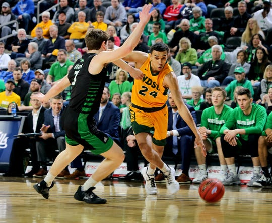 SIOUX FALLS, SD - MARCH 10: Tyson Ward #24 of the North Dakota State Bison drives to the basket against Billy Brown #3 of the North Dakota Fighting Hawks during the men's championship game at the 2020 Summit League Basketball Tournament in Sioux Falls, SD. (Photo by Dave Eggen/Inertia)