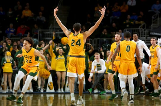 SIOUX FALLS, SD - MARCH 10: Tyson Ward #24 of the North Dakota State Bison celebrates during a timeout against North Dakota Fighting Hawks during the men's championship game at the 2020 Summit League Basketball Tournament in Sioux Falls, SD. (Photo by Dave Eggen/Inertia)
