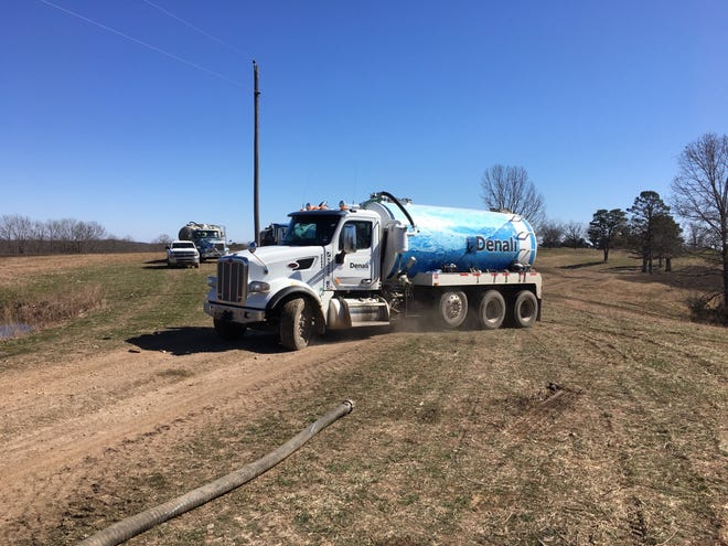 A Denali Water Solutions truck delivers a load of liquid hog manure from Arkansas to be spread on a ranch in Taney County.