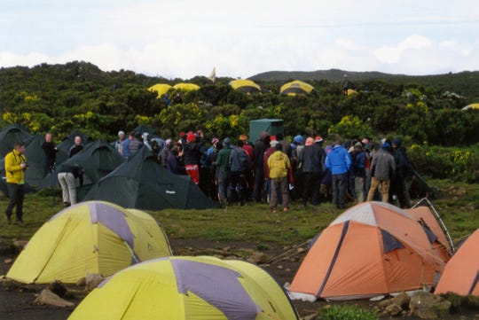 A group of guides from Tusker Trails gather to sing a morning song at a low camp on Mount Kilimanjaro in early 2020.