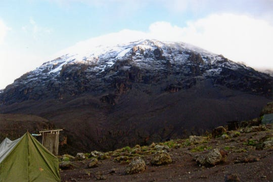 Sunrise hits the peak of Mount Kilimanjaro, where glaciers have long since melted away, in Tanzania, early 2020.
