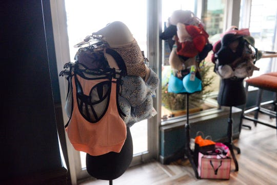 Event attendees place bra donations on mannequins at the front of the room when entering. The donations accrue throughout March and then are given to Anna Marie's Alliance.