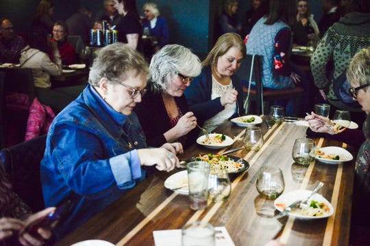 Kathryn Stolpman, left, and her companions taste Jules' Bistro dishes during Lift Up the Ladies. Stolpman and a group of women attended every Lift Up the Ladies event in 2019 and both held in 2020 as of Monday, March 9.