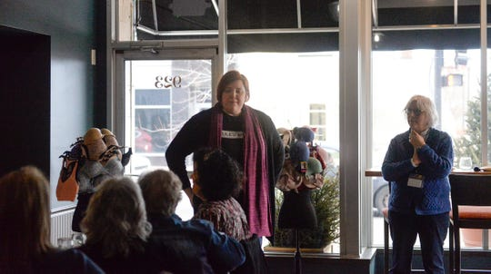 Jules' Bistro owner Donella Westphal and Anna Marie's ALiance Director of Development Sandy Nadeau address the approximately 40 people gathered at Jules' Monday, March 9, 2020 to thank them for their donations and support.