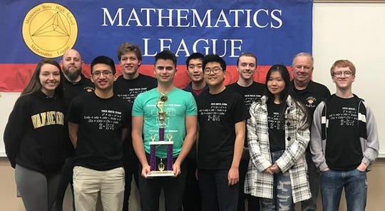 Tech's math team is pictured after winning the state championship Tuesday. Pictured from the back is coach Ben Thell , Monty Truitt, Colin Cai, Harrison Gauerke, and assistant coach Mick Boatz. In the front is Maddie Preppernau, Vinh Nguyen, Richard Zimring, John Byun, Trinh Tran and Alex Barker.